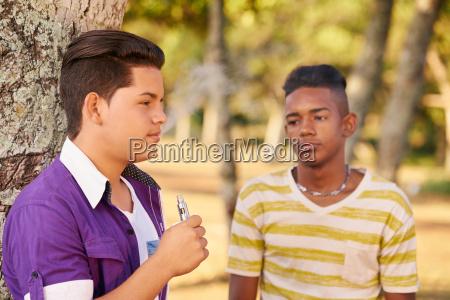 teenager boy smoking e cig electronic
