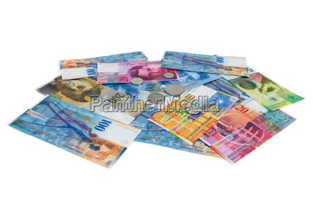 heap von schweizerem franken banknoten und