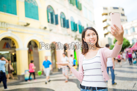young woman taking photo by cellphone