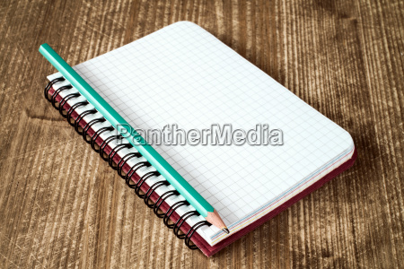 close up of spiral notebook and