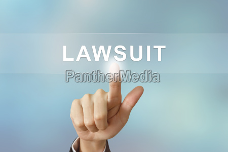 business hand clicking lawsuit button on
