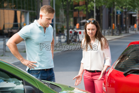 couple looking at car collision