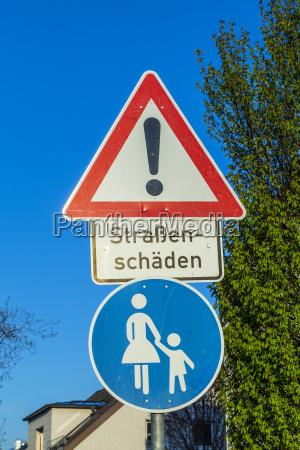 sign strassenschaeden road damage