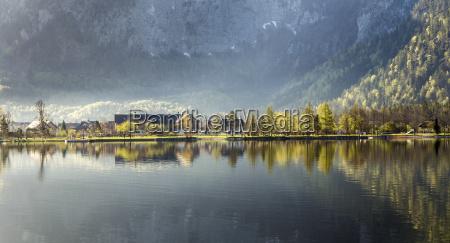 reflection of village obertraun in hallstatt