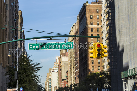 street sign suspended above central park
