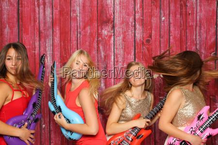 wild girl playing on plastic guitars