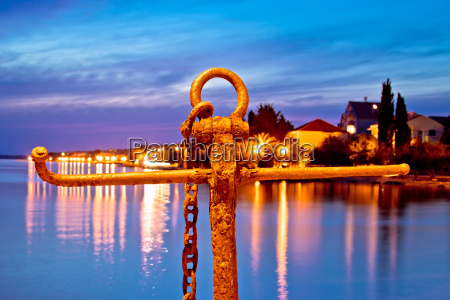 rusty anchor view at blue evening