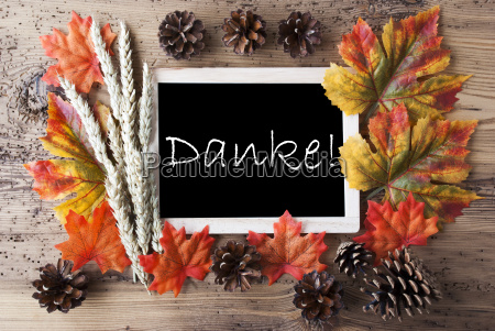 chalkboard with autumn decoration danke means