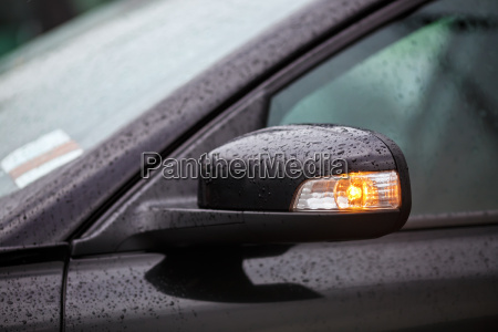 car mirror with rain drops