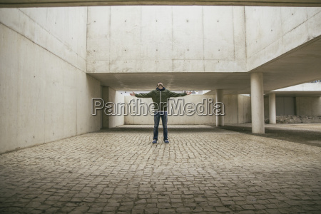 man with arms outstretched and head