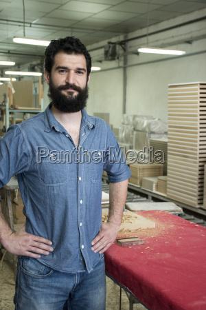 portrait of carpenter smiling