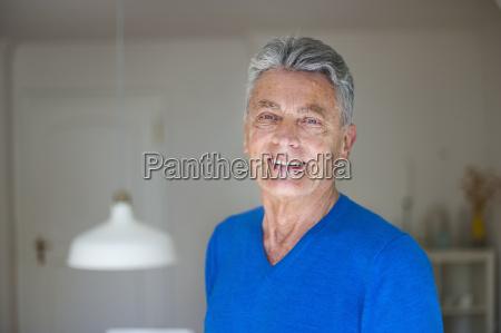 portrait of smiling senior man at