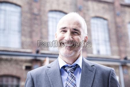 mature businessman smiling portrait