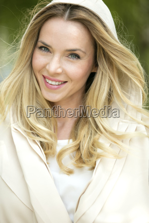 portrait of smiling blond woman wearing