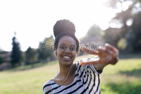 portrait of happy woman hearing music