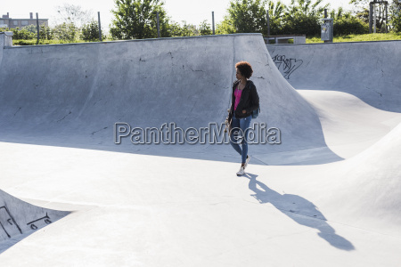 young woman walking in skatepark