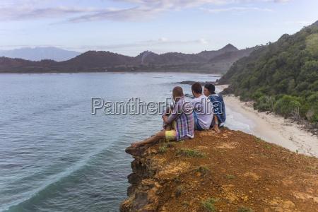 indonesia sumbawa island young people sitting