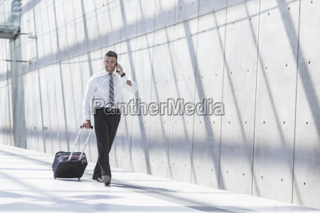businessman with luggage and cell phone
