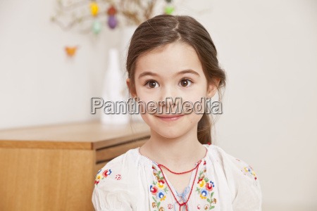 portrait of smiling little girl looking