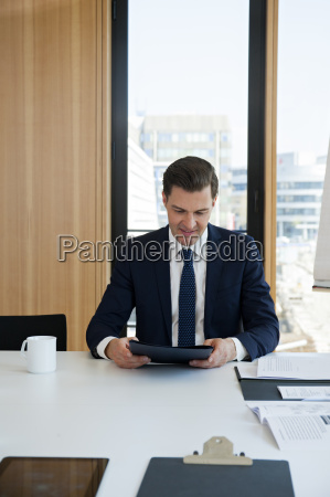 portrait of businessman at office desk