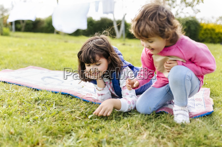 two girls playing on a meadow