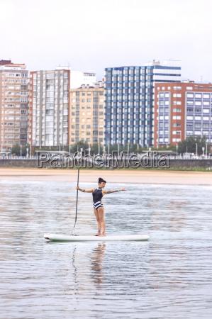spain gijon woman practicing paddle board