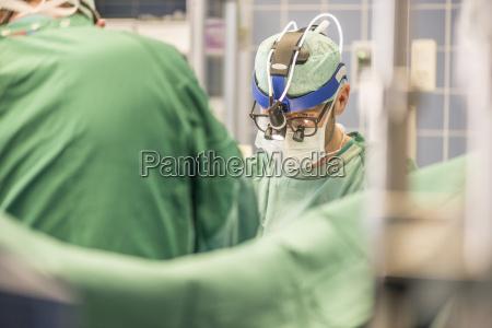 surgeons executing heart bypass surgery