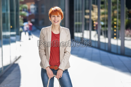 portrait of happy fashionable young woman
