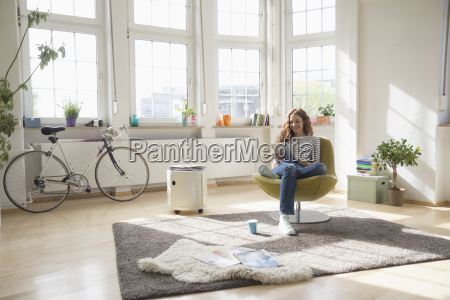 woman at home sitting in chair