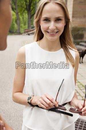 portrait of smiling woman communicating