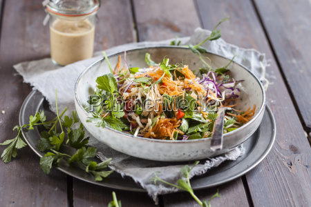 rainbow salad with spinach leaves peas