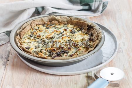 baking dish of green asparagus tart