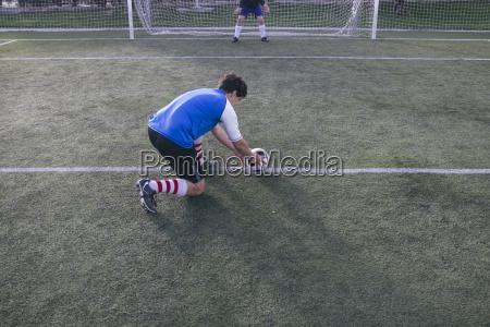 football player placing the ball on