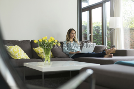 woman at home sitting on couch
