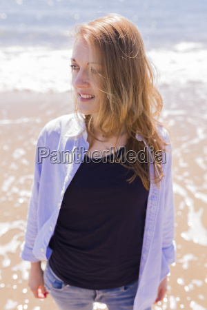 smiling young woman at seaside