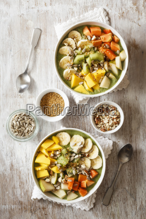 smoothie bowl with different fruits mango