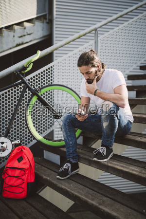 young man sitting on stairs looking