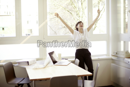 laughing woman doing stretching exercise in
