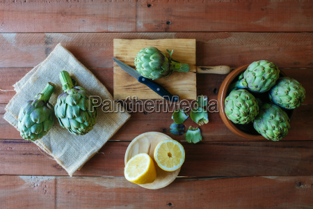 raw artichokes and sliced lemon on