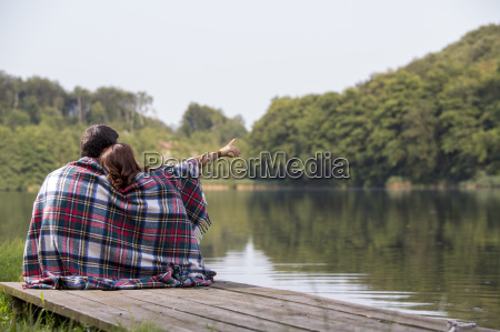 back view of young couple sitting