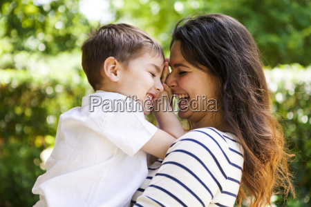 happy mother and son hugging outdoors