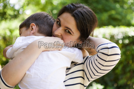 mother holding son outdoors