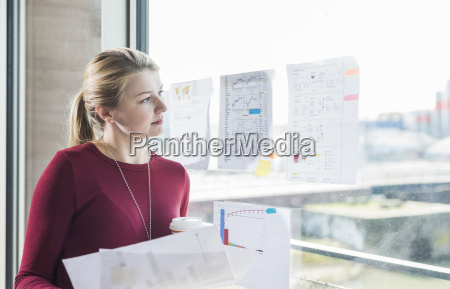 young woman looking at graphs on