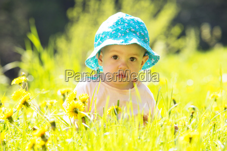 portrait of baby girl wearing hat