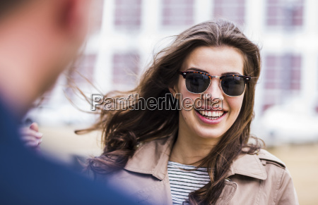 happy young woman wearing sunglasses portrait