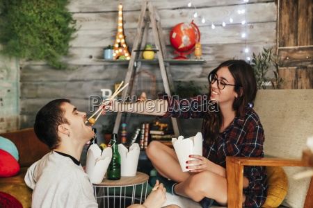 young couple eating chinese take away