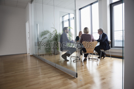 business people having team meeting in