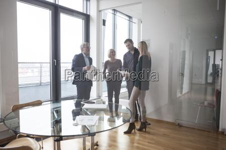 business people having team meeting in