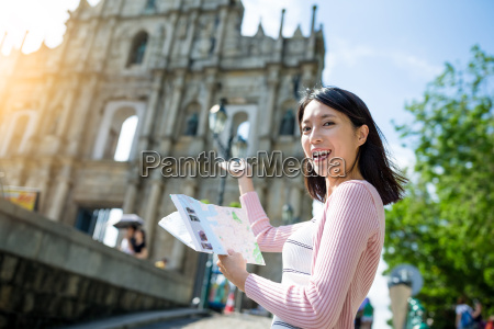 woman holding city guide in macao