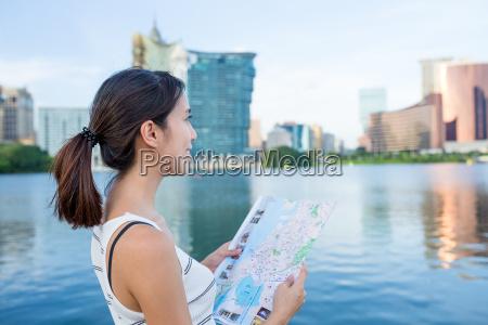 woman using city map in macau